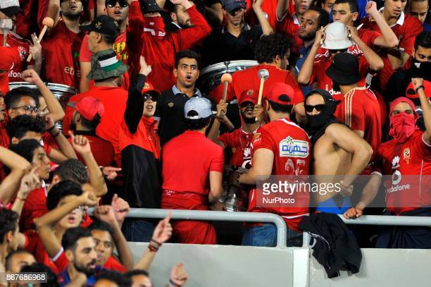 AlAhly supporters cheer for their team during the CAF Champions League final football match between AlAhly vs Wydad Casablanca at the Borg El Arab...