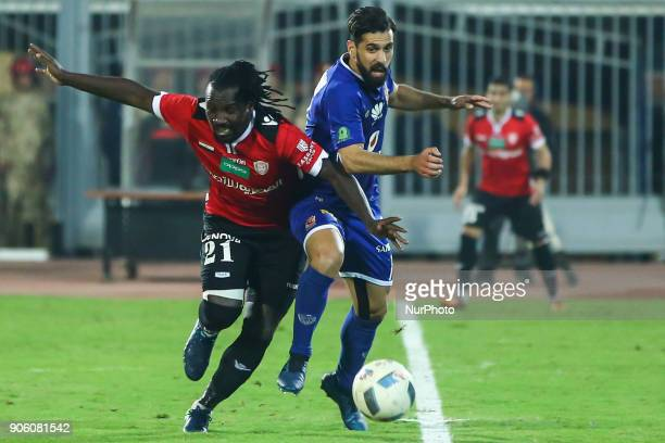 Alahly's Abduallah Said and AlGish Franck Engonga in Action during the Egypt Primer League Fixtures 18 Match Between AlAhly and AlGish in Cairo on 16...