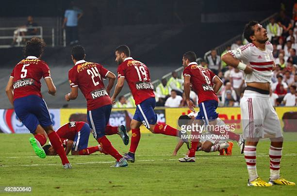AlAhly's Abdulla Elsaed celebrates with teammates after scoring during the Egypt super cup football match between AlAhly SC and Zamalek Egyptian...