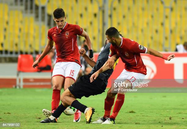 AlAhly's Ahmed AlSheikh vies for the ball with Esperance of Tunis' Ahmed Youssef during the CAF Champions League quarterfinal firstleg football match...