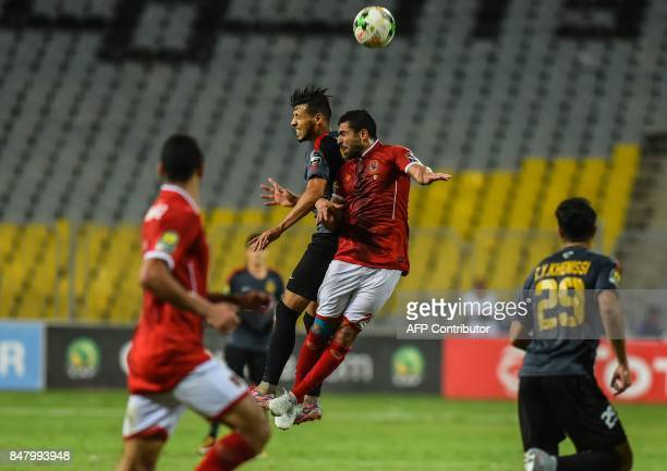 AlAhly's Ahmed Fathi heads the ball during the CAF Champions League quarterfinal firstleg football match between Egypt's AlAhly and Tunisia's...