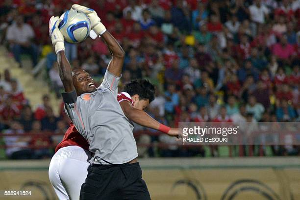AlAhly's Amr Gamal vies with goalkeeper Zesco United's Jacob Banda during the Confederation of African Football Champions League group A match...