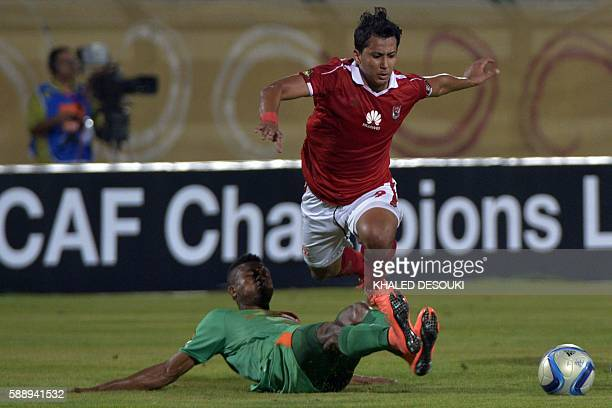 AlAhly's Amr Gamal vies with Zesco United's Adama Ben Bahn during the Confederation of African Football Champions League group A match between...