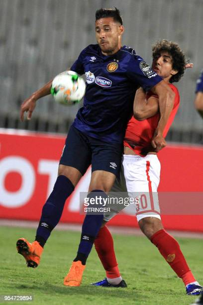 AlAhly's Egyptian defender Mohamed Hany vies for the ball against ES Tunis' Tunisian defender Houcine Rabii during their CAF Champions League group A...