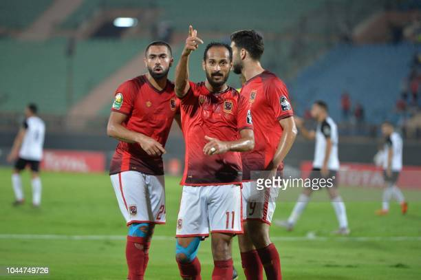 AlAhly's Egyptian forward Walid Soliman celebrates with teammates after scoring during the CAF Champions League semifinal first leg football match...