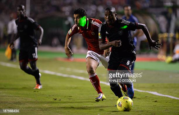 AlAhly's Egyptian midfielder Abdallah ElSaid fight for the ball against Orlando Pirates' South African defender Thabo Matlaba during the CAF...