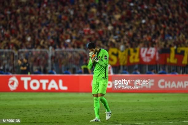 AlAhly's goalkeeper Sherif Ekramy reacts after Esperance of Tunis scored a goal during the CAF Champions League quarterfinal firstleg football match...