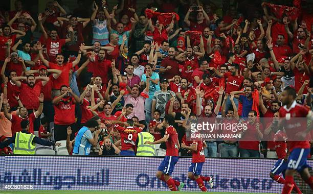AlAhly's players celebrate after scoring a third goal during the Egypt super cup football match between AlAhly SC and Zamalek Egyptian football clubs...