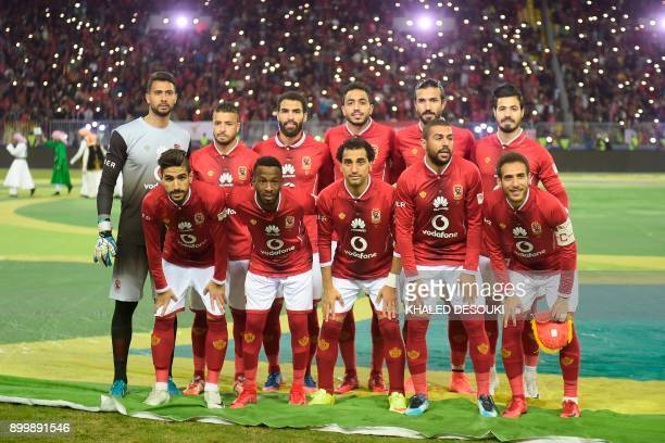 AlAhly's players pose for a group picture prior to the friendly football match between Egypts AlAhly and Spains Atletico Madrid at Borg alArab...