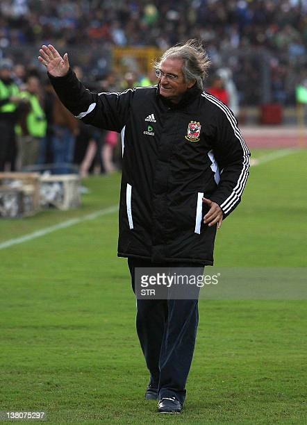 AlAhly's Portuguese coach Manuel Jose waves at supporters before his team's football match against AlMasry in the Egyptian coastal city of Port Said...
