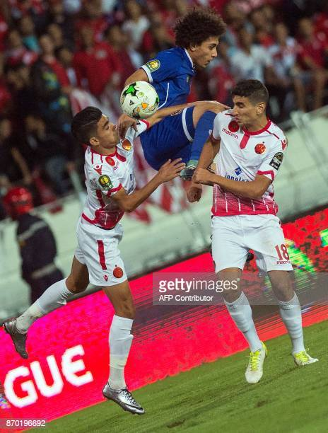 AlAhly's Sherif Ekramy vies for the ball during the CAF Champions League final football match between Egypt's AlAhly and Morocco's Wydad Casablanca...