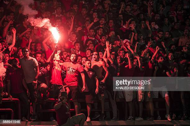 AlAhly's supporters cheer their team during the Confederation of African Football Champions League group A match between Egypt's AlAhly and Zambia's...