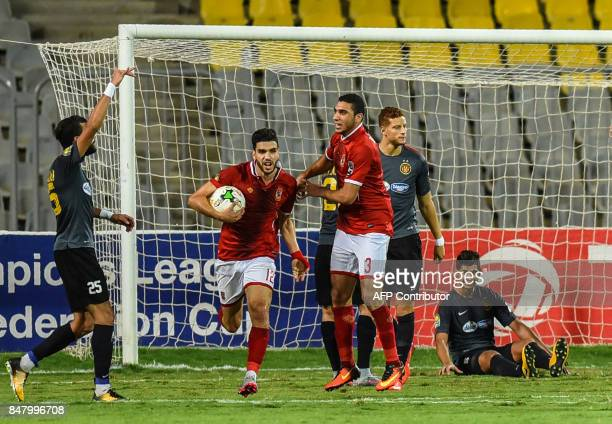 AlAhly's Walid Azaro celebrates after scoring the second goal during the CAF Champions League quarterfinal firstleg football match between Egypt's...