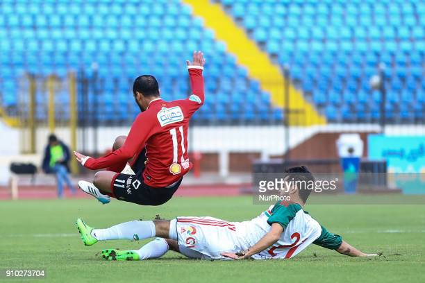 AlAhly's Walid Soliman in action with Ayman Muhammadi during the Egypt Primer League Fixtures 20 Match Between AlAhly and AlRajaa in Alexandria...