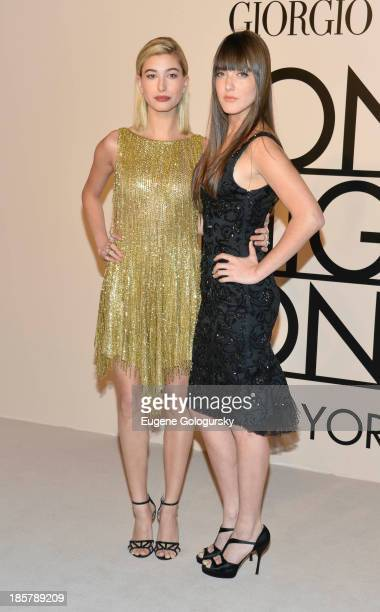 Alaia Baldwin and Haley Baldwin attend Armani One Night Only New York at SuperPier on October 24 2013 in New York City