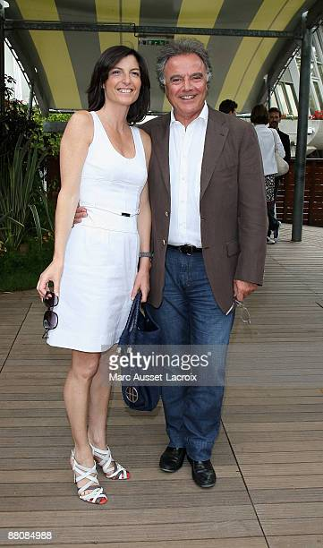 Alain Afflelou and a guest attend the French Open at Roland Garros on May 31 2009 in Paris France
