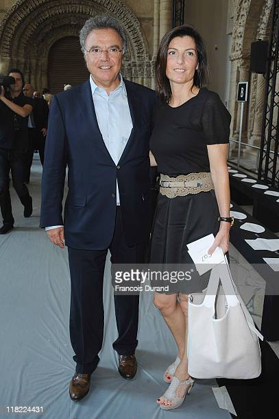 Alain Afflelou and Christine Couland attend the Stephane Rolland Haute Couture Fall/Winter 2011/2012 show as part of Paris Fashion Week at Cite de...