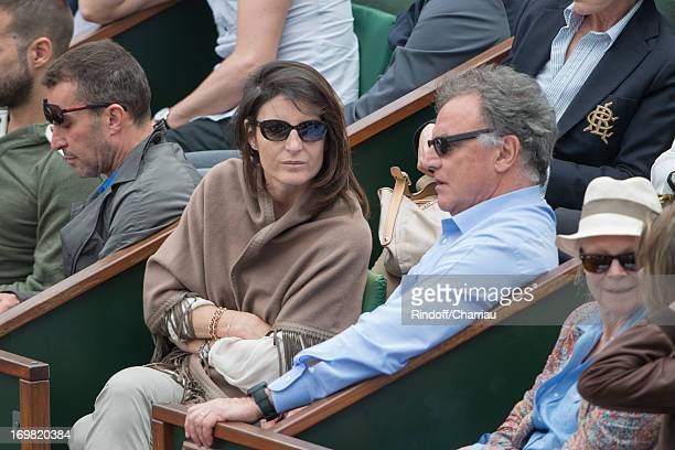 Alain Afflelou and guest sighting at the French open 2013 at Roland Garros on June 2 2013 in Paris France