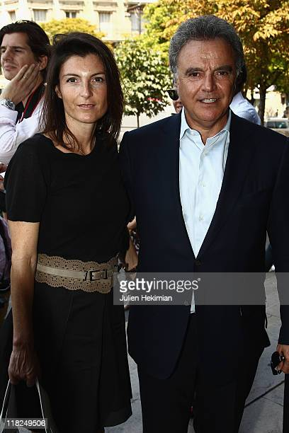 Alain Afflelou and his wife arrive for the Stephane Rolland Haute Couture Fall/Winter 2011/2012 show as part of Paris Fashion Week on July 5 2011 in...