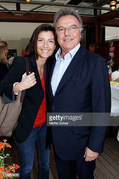 Alain Afflelou and his wife attend The French Open at Roland Garros on May 27 2011 in Paris France
