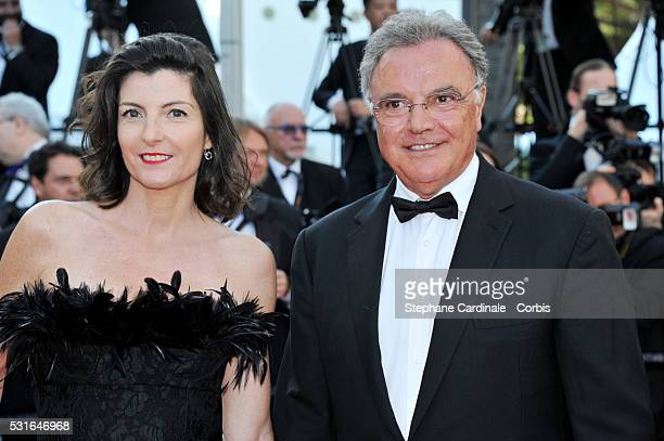 Alain Afflelou and his wife attend the From The Land Of The Moon premiere during the 69th annual Cannes Film Festival at the Palais des Festivals on...