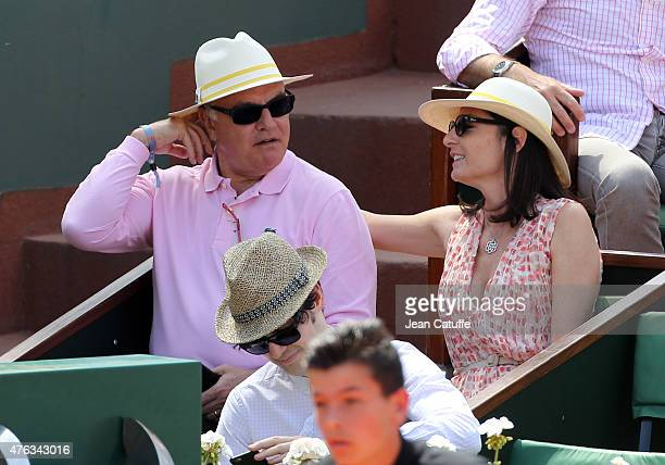 Alain Afflelou and his wife Christine Afflelou attend the men's final on day 15 of the French Open 2015 at Roland Garros stadium on June 56 2015 in...