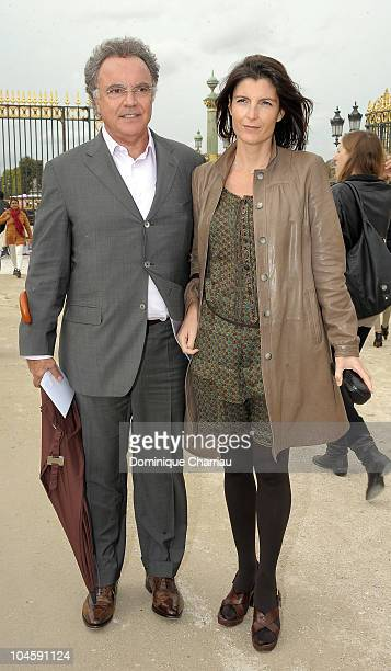 Alain Afflelou and his wife Christine arrive for the Christian Dior Ready to Wear Spring/Summer 2011 show during Paris Fashion Week at Espace...
