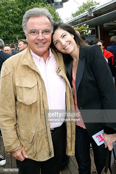 Alain Afflelou and wife Christine attend Roland Garros Tennis French Open 2013 Day 7 on June 1 2013 in Paris France