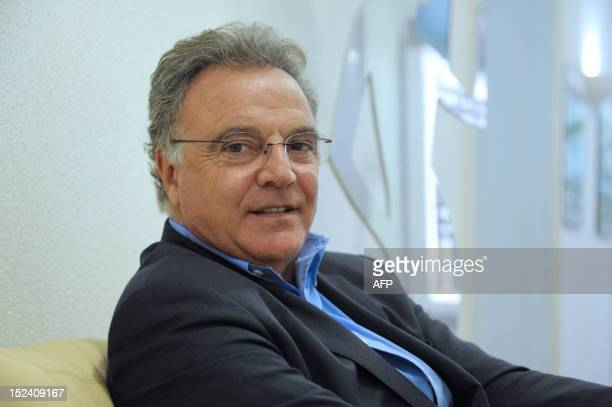 Alain Afflelou founder of French optic retailer eponym group poses on September 20 2012 at the group headquarters in Paris On April 2012 Private...