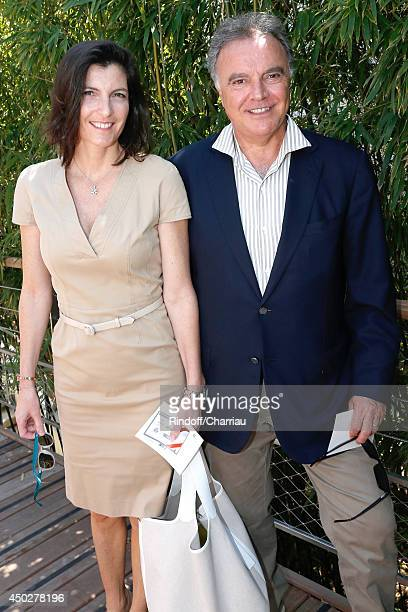 Alain Afflelou with his wife Christine Afflelou attend the Men's Final of Roland Garros French Tennis Open 2014 Day 15 on June 8 2014 in Paris France