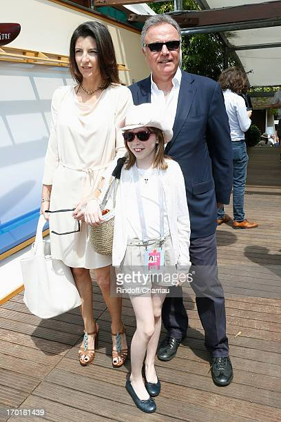 Alain Afflelou with his wife Christine and their daughter Clara sighting at Roland Garros Tennis French Open 2013 Day 14 on June 8 2013 in Paris...