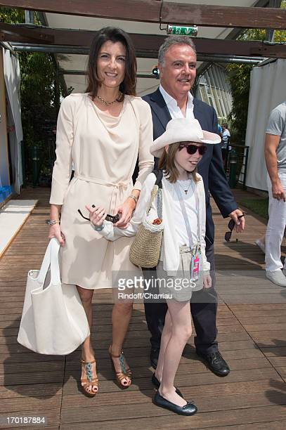 Alain Afflelou with his wife Christine and their daughter Clara at Roland Garros on June 8 2013 in Paris France