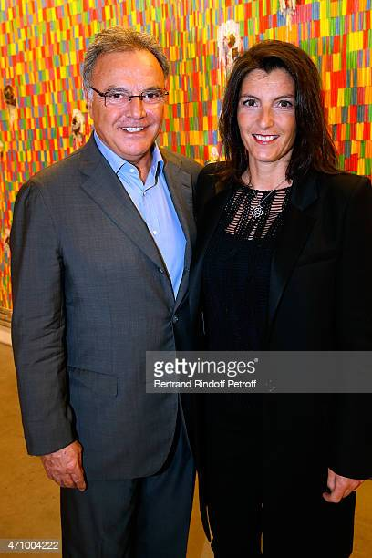 Alain Afflelou with his wife Christine attend the 'A Moment of Reconstruction' Informal Dinner and Concert held at VNH Gallery on April 24 2015 in...