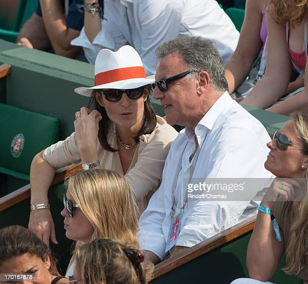 Alain Afflelou with his wife Christine sighting at the french open 2013 at Roland Garros on June 8 2013 in Paris France