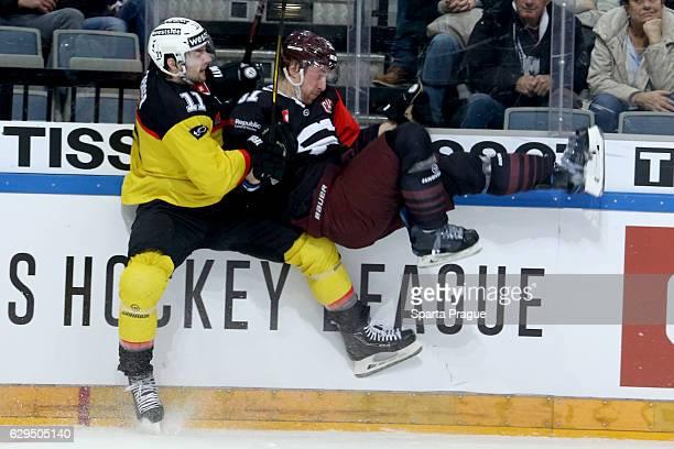 Alain Berger of Bern hits Jan Svrcek of HC Sparta Prague during the Champions Hockey League Quarter Final match between Sparta Prague and SC Bern at...