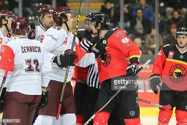 Alain Berger of Bern tangles with Martin Gernat of Prague during the Champions Hockey League Quarter Final match between SC Bern and Sparta Prague at...