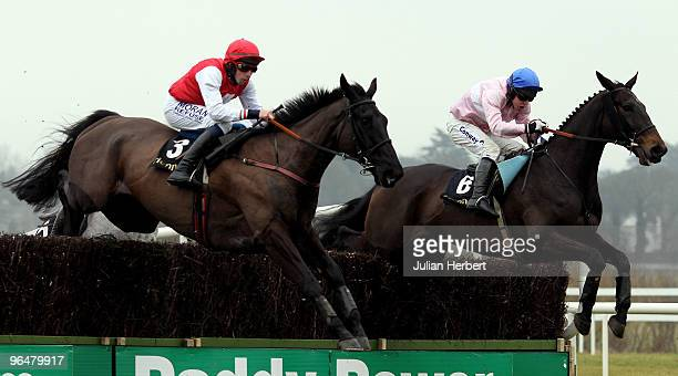 Alain Cawley and Joncol clear an ealy fence in company with the Andrew Lynch ridden Notre Pere before landing The Hennessy Gold Cop Steeplechase Race...