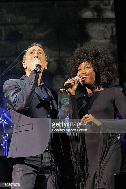 Alain Chamfort and Inna Modja perform at Le Grand Rex on January 30 2013 in Paris France