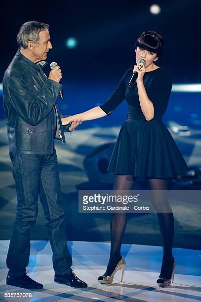 Alain Chamfort and Nolwenn Leroy perform on stage during Les Victoires de La Musique 2012 at Palais des Congres in Paris