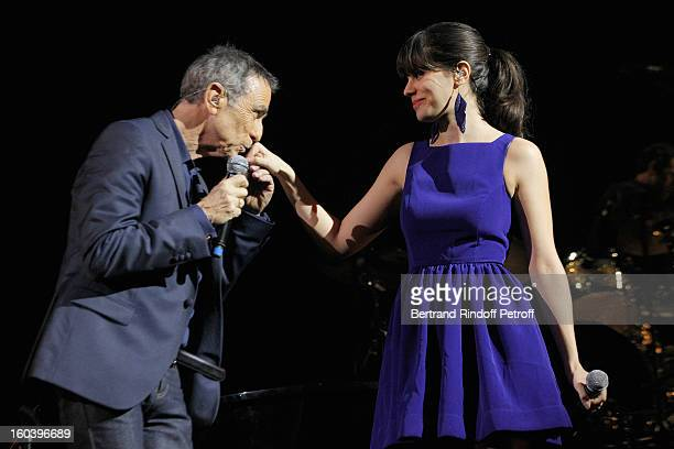 Alain Chamfort kisses the hand of Sarah Manesse after they performed at Le Grand Rex on January 30 2013 in Paris France