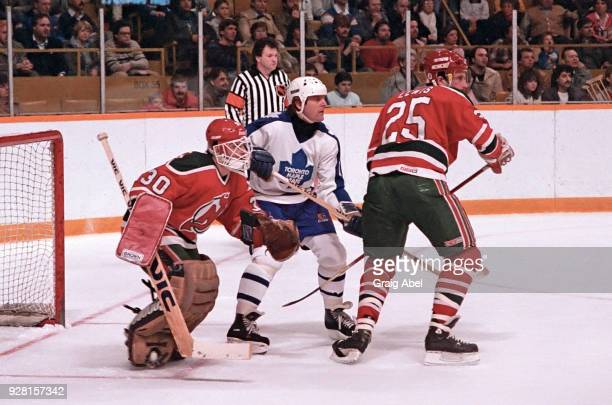 Alain Chevrier and Dave Lewis of the New Jersey Devils skate against Marian Stastny of the Toronto Maple Leafs during NHL game action on March 22...