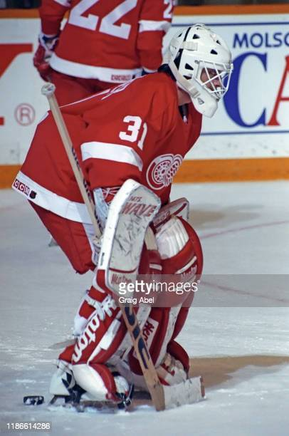 Alain Chevrier of the Detroit Red Wings skates against the Toronto Maple Leafs during NHL game action on November 17 1990 at Maple Leaf Gardens in...