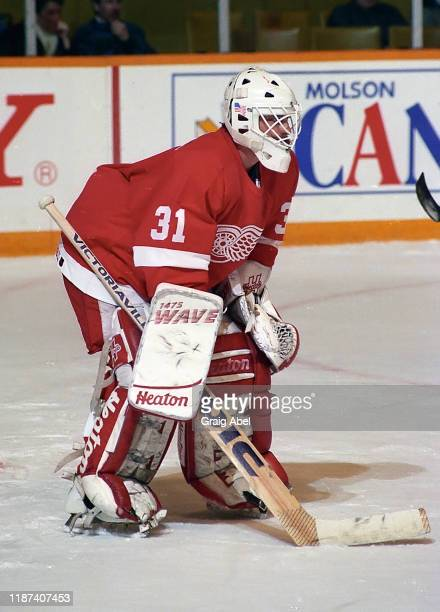 Alain Chevrier of the Detroit Red Wings skates against the Toronto Maple Leafs during NHL game action on February 2 1991 at Maple Leaf Gardens in...