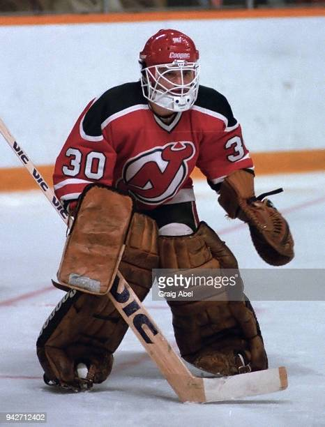 Alain Chevrier of the New Jersey Devils skates against the Toronto Maple Leafs during NHL game action on December 4 1985 at Maple Leaf Gardens in...