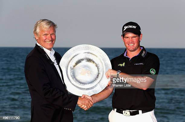 Alain de Soultrait Director of the Challenge Tour poses with Ricardo Gouveia of Portugal as winner of the Road to Oman Rankings trophy after winning...