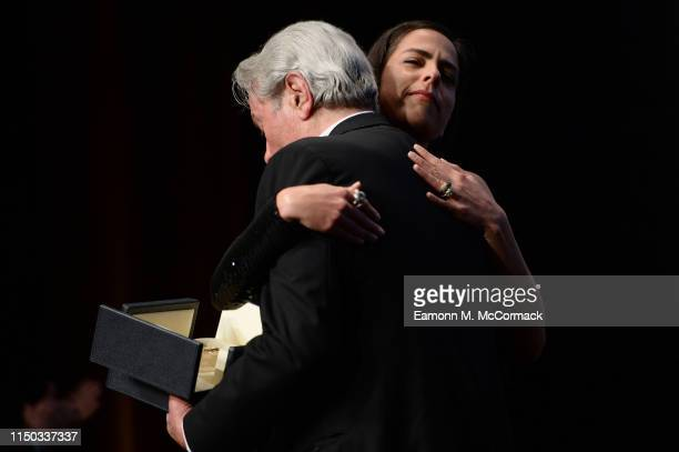 Alain Delon accepts the Palme d'Or d'Honneur awayrd from his daughter Anouchka Delon during the Ceremony for Palme Honneur during the 72nd annual...