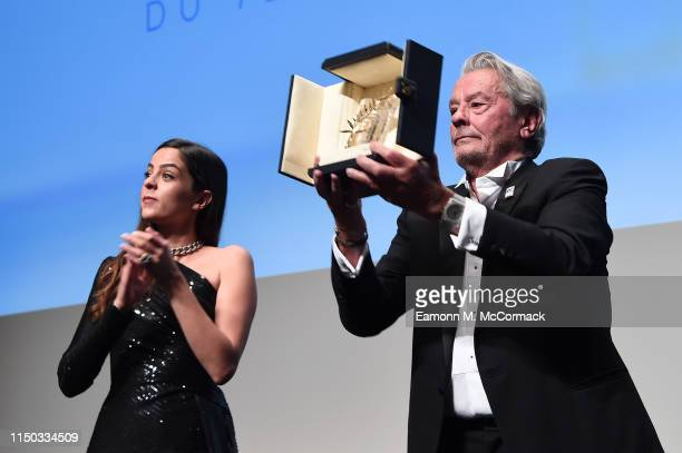 Alain Delon accepts the Palme d'Or d'Honneur with his daughter Anouchka Delon during the Ceremony for Palme Honneur during during the 72nd annual...