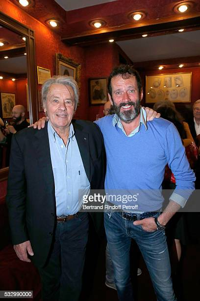 Alain Delon and actor of the piece hristian Vadim attend the 100th representation of the Theater piece 'Un nouveau depart' at Theatre Des Varietes on...
