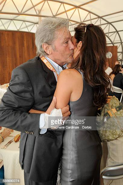 Alain Delon and Astrid Veillon attend the Breitling lunch during the 48th Paris Air Show held at Paris Le Bourget