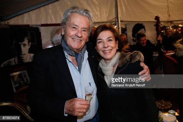 Alain Delon and Carole Amiel attend 'La Grande Roue de Paris' Opening Ceremony at Place de la Condorde on the Champs Elysees on November 17 2017 in...